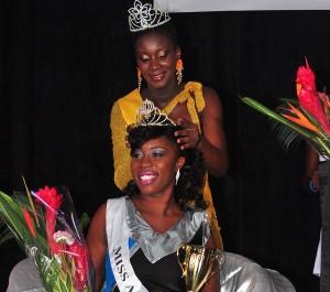 Miss BWU Netball being crowned by last year's winner Shekira Boxill.