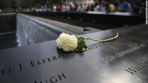 A flower lies atop names of victims at the 9/11 Memorial in New York.