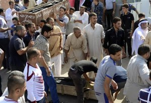 Mourners carry the coffin of a victim of a bomb attack during a funeral in Samarra roday.
