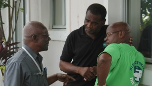 BWU general secretary Sir Roy Trotman discusses strategy with representatives of the BWA's union division.
