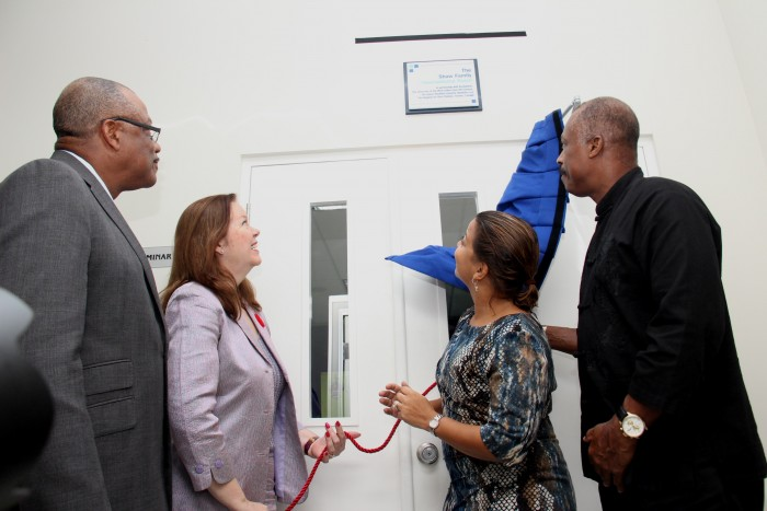 (left to right) Minister of Health John Boyce; Virginia Shaw-Hutchinson of the Leslois Shaw Foundation, a lead donor; Claire Jordan of Scotiabank, a partner of the Telemedicine initiative; and principal of the UWI Cave Hill Campus Sir Hilary Beckles at the unveiling.