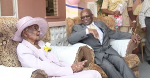 Centenarian Mary Phillips had Governor General Sir Elliot Belgrave smiling throughout his visit with her.