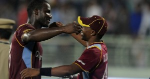 Dwayne Bravo captain of West Indies congratulates team mate Darren Sammy of West Indies after the win during the second Star Sports One Day International (ODI) match between India and The West Indies held at the Dr. Y.S. Rajasekhara Reddy ACA-VDCA Cricket Stadium, Vishakhapatnam, India. (Photo by: Pal Pillai - BCCI - SPORTZPICS)