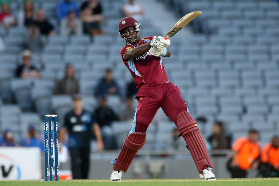 Darren Sammy hits a scorching boundary.