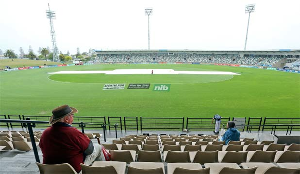 Covers protect the wicket during a rain delay at McLean Park in Napier. (Photo: Getty Images)