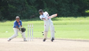 Shaqukere Parris cover-driving for a boundary during his top score of 20 for Eden Lodge.