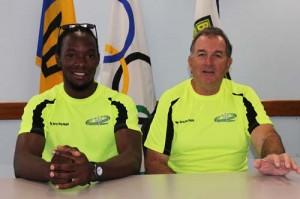 Coach Joe Whipple (right) with Barbados captain Sean Ward.