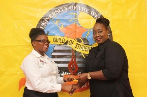 UWI Humanities and Education representative Emmanuella Louis (left) presenting Chrystal Cummins Beckles with her award.