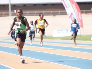 Good Shepherd's Diallo Thompson winning the Under-13 boys' 200m.