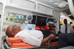 Ambulance officer Andrew Brathwaite is tended by emergency medical technician Derrick Cumberbatch.