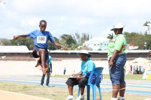 J'Nov Davis of St Mark's Primary jumping to victory in the under-11 boys' long jump.