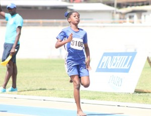 Kelescia Downes of Arthur Smith Primary winning the under-nine girls' 100M.
