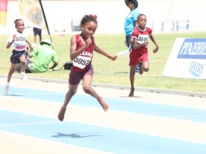 Samiya Dell of Sharon Primary running away from the field in the under-nine 80M.
