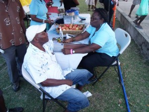 A visitor to the Barbados Diabetes Association booth gets his blood pressure checked.