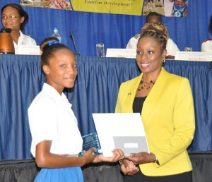 Miracle Ann King from Deighton Griffith who placed third in the competition accepting    her prizes.