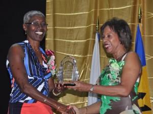 Deborah Lynch-Theobalds (left) receiving her Lifetime award from Molly Rhone.