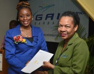 Senator Irene Sandiford-Garner presenting certificate to June Forde.