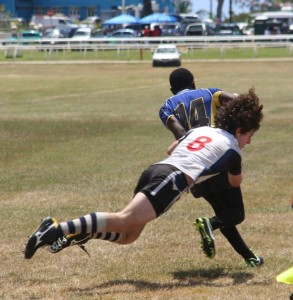 St. Mary's Catholic School's players were quite adept at these flying tackles on the Barbados players.