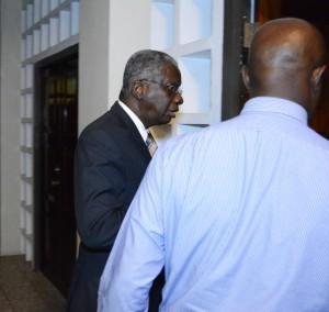 Prime Minister Freundel Stuart leaving the meeting.