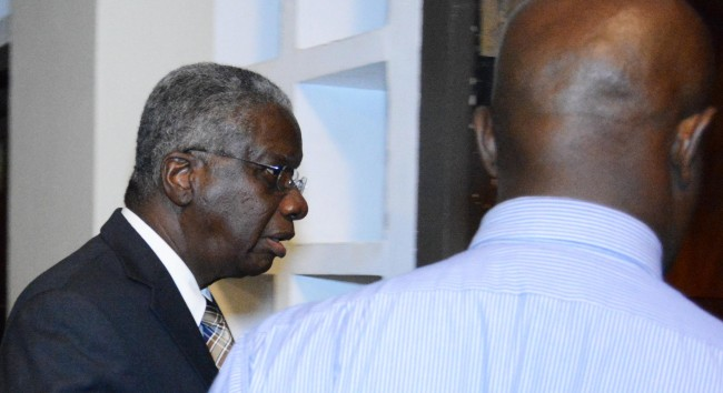 Prime Minister Freundel Stuart leaving the meeting.