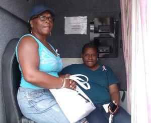 Two shoppers awaiting their turn for Barbados Cancer Society breast screening.