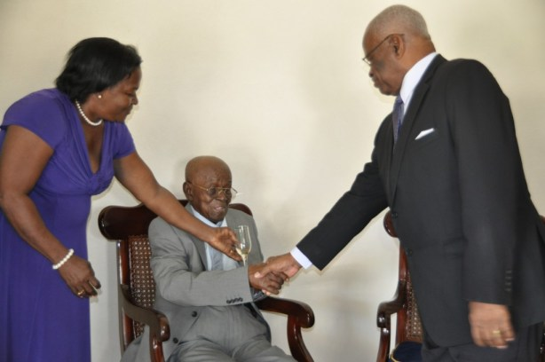 Centenarian Olive Jackman (centre) had his wish come true when Govenor General Sir Elliot Belgrave visited him on his 100th birthday.