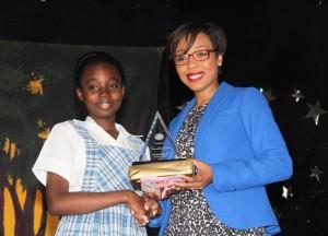Samantha Greene the top reader accepting her award from SOL Caribbean Ltd representative Gina Cummins.