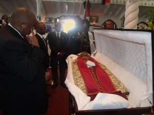Minister of Culture, Stephen Lashley (second left) this morning viewing the body of Archbishop, Dr Granville Williams.