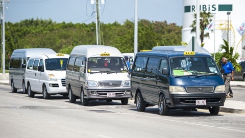 Taxis line up at the Owen Roberts International Airport on Monday. Another 30 taxis have been licensed.