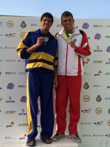 Christian Selby (left) shows off his medals.
