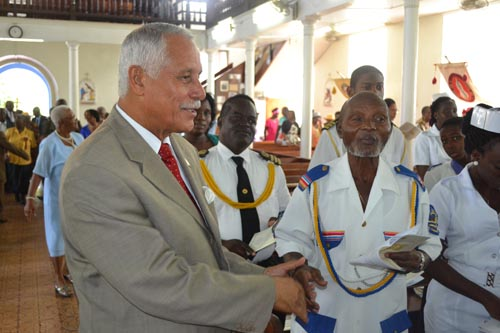 BFPA executive director George Griffith greeting a member of the congregation.