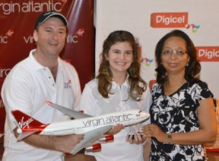 Mavi Vergos receiving her prizes from general manager of Virgin Atlantic Nick Parker and general manager of Barbados Golf Club, Betty-June Leacock.