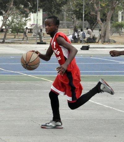 Queen's College's Makaari Jones bringing the ball up-court.