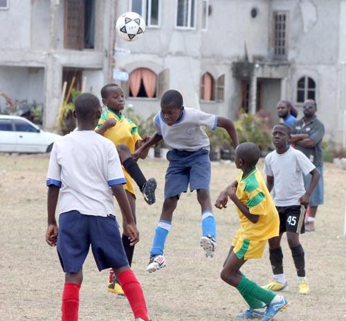 Selah's goal-scorer Shamario DePeiza heading the ball to safety.