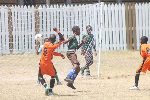 Striker Zuhri Morris (number 9) blasts a goal past Grazettes Primary's goalkeeper Tyreke Scantlebury.