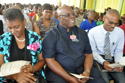 Retired teacher Charles Ifill (centre) enjoying his retirement function at the Hillaby Turner's Hall Primary School with his wife Annie (left) and the school's principal Charles Hinds.