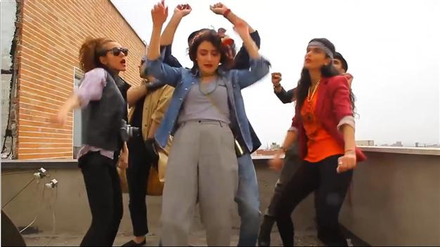 The video shows people dancing to Pharrell's single in and around Tehran.