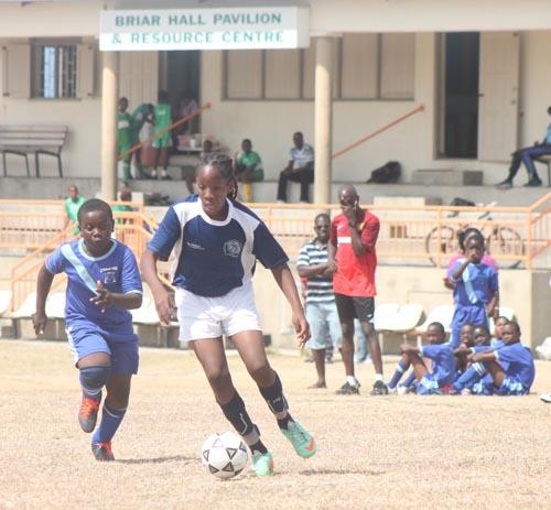 Wills Primary midfielder Abiola Grant leaves St Bartholomew's right-back Danon Scott in her wake as she heads up-field.