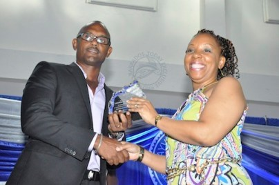 Sophia Yearwood was presented with her award by Kwame Connell, a member of the board of directors.
