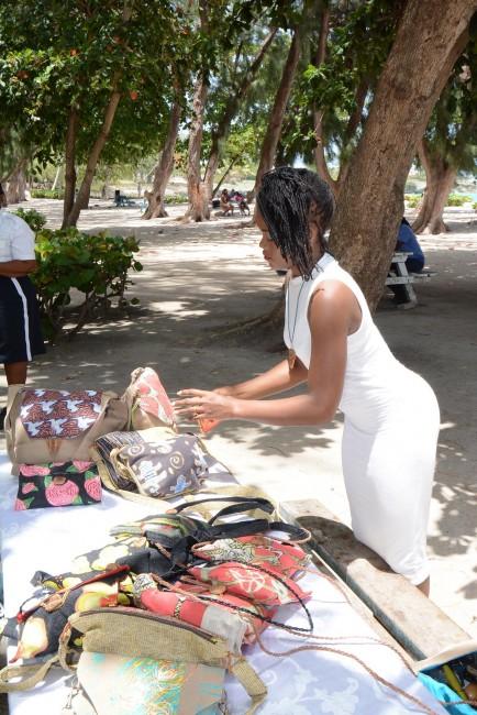 Shanika Grimes displaying her work at Miami Beach.