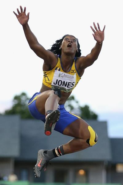 Akela Jones soars through the air during her gold medal-winning jump.