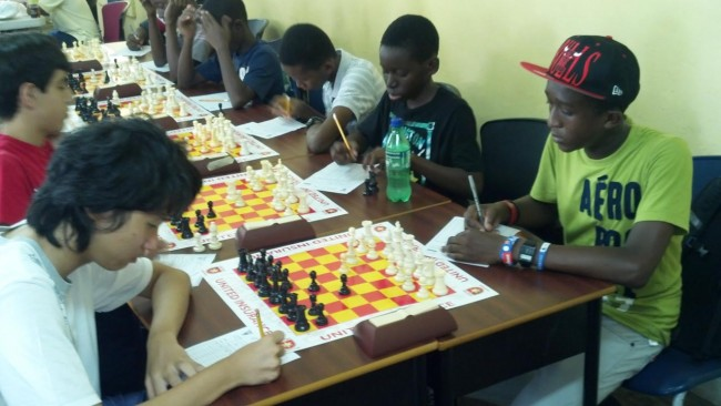 Top players in the Under-16 section led by Yu Tien Poon (left) in deep concentration.