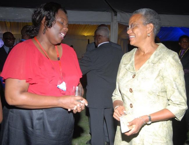 St John MP Mara Thompson (right) enjoying the company of House of Assembly staffer Ruth Linton.