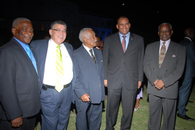 Former parliamentarian Sir Frederick Smith (centre) seems to be the centre of attention in this group that included (from right) Governor General Sir Elliott Belgrave and Acting Prime Minister Richard Sealy.