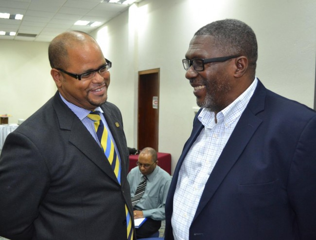Private Sector Association chairman Alex McDonald (left) and Senator Harry Husbands.
