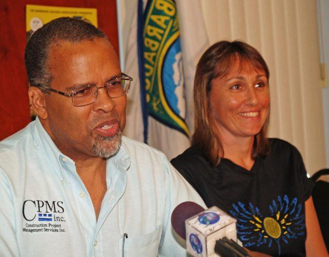 Craig Archer (left) delivering remarks at the media conference as Karen Meakins look on.