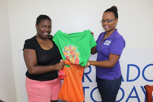 Terriesha Niles, a representatives of Barbados TODAY's Sales and Marketing Department hands over the Foreday Morning costume to Akeila Pile.