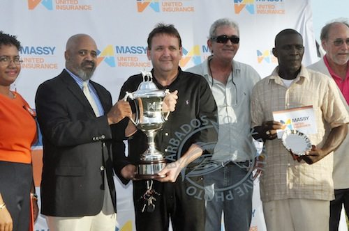 Proudly holding the Barbados Derby Cup are (left) Massy United CEO Howard Hall and breeder Geoffrey Bynoe.