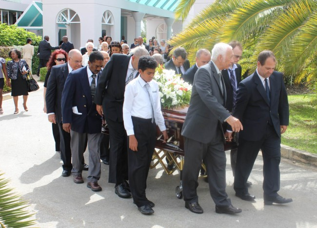 Pallbearers, led by John Williams, former head of the Barbados Private Sector Association (far right), taking the casket to the burial spot.