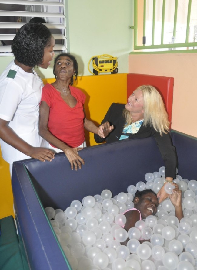 Patient Latoya Holmes (right) enjoying the comfort of stimulation and soothing equipment as trustee Pippa Challis (at right), patient Marguerita Absalom (second from left) and nurse Jamekica Brathwaite interact with each other.